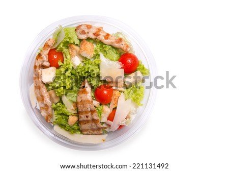 Caesar salad with grilled chicken meat, top view isolated on white background  - stock photo