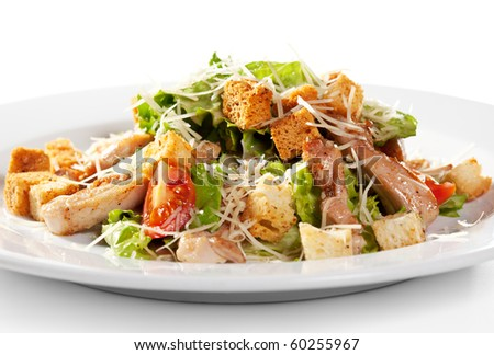 Caesar Salad with Meat. Comprises Romaine Salad Leaf and Croutons Dressed with Parmesan Cheese - stock photo
