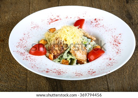 Caesar salad with parmesan cheese and tomato - stock photo