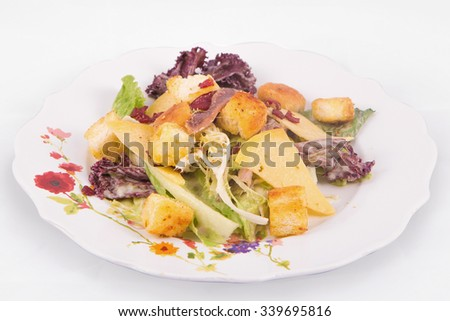 Caesar salad with parmesan cheese, lettuce, anchovy, croutons, bacon, and mayonnaise - stock photo
