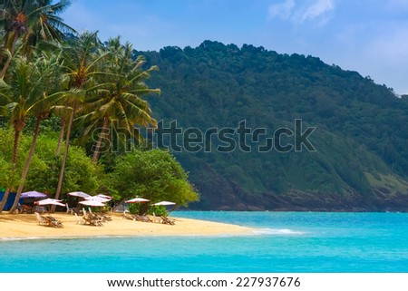 Cafe at remote tropical white sand ocean beach  - stock photo