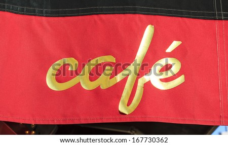 Cafe canopy in Paris, France. Golden letters on red canvas - stock photo