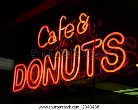 Cafe & donuts neon sign in New York City - stock photo