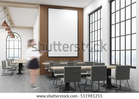 cafe interior with large vertical poster on brick wall woman waiter is standing near one - Large Cafe Interior