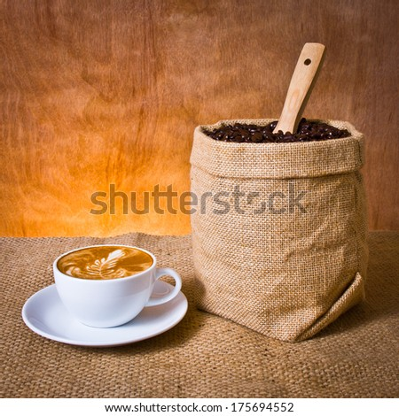 cafe latte and coffee beans in burlap - stock photo