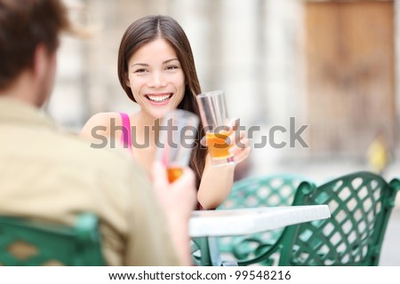 Cafe lifestyle woman drinking rum on sidewalk cafe with friends during on travel vacation in Old Havana, Cuba, Plaza de la Catedral. - stock photo