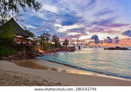 Cafe on Seychelles tropical beach at sunset - nature background - stock photo