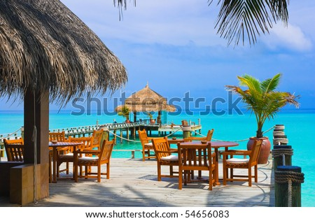 Cafe on the beach, ocean and sky - stock photo