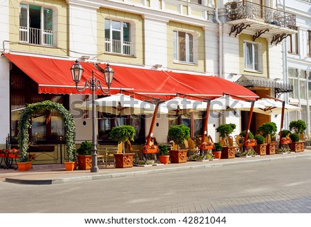 Cafe on the street of old European city - stock photo