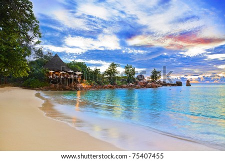 Cafe on tropical beach at sunset - nature background - stock photo