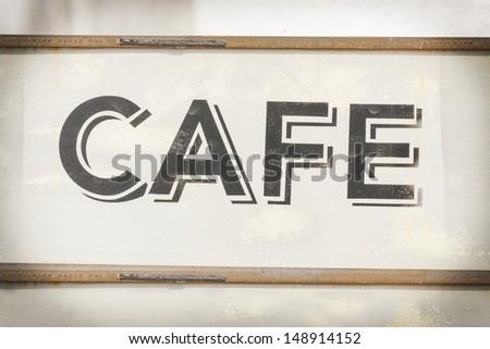 Cafe sign along historic Kamouong street in Vang Vieng, Laos.Vintage Processing. - stock photo