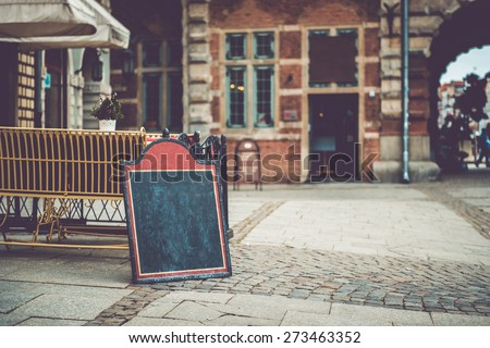 Cafe sign with space for text in an old European city - stock photo