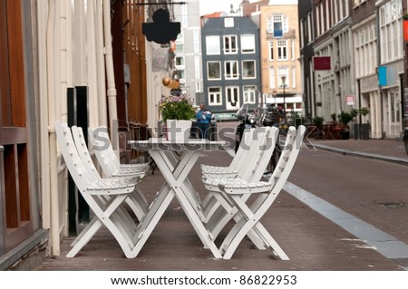 Cafe table on a street, Amsterdam - stock photo