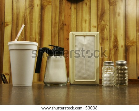 Cafe table with condiments - stock photo