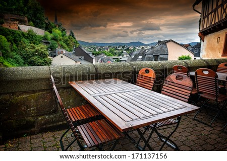 Cafe terrace in small European town  - stock photo