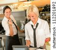 Cafe waitress cashes in order bill register woman working happy - stock photo
