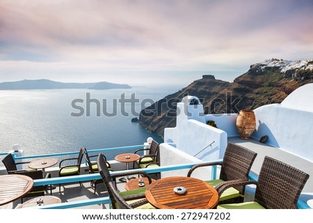 Cafe with sea view at sunset. Beautiful landscape, Santorini island, Greece.  - stock photo