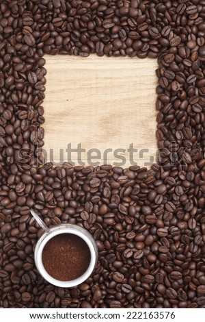 Caffe edition, coffee beans on a wooden background