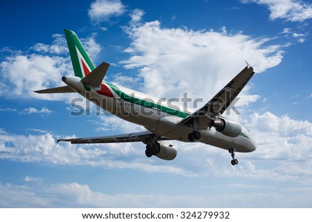 Cagliari - 4/10/2015 : Airbus A320 Alitalia landing to Cagliari Elmas Airport (LIEE) on runway 14 - stock photo