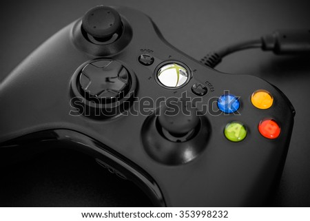 Cagliari - December 20, 2015: Close view of the Microsoft Xbox 360 Controller on black background. - stock photo