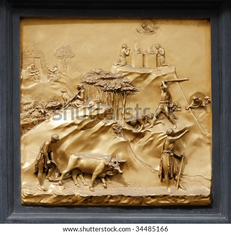 """Cain and Abel by Ghiberti. Detail of the panel on the doors (""""Gates of Paradise"""") of the Duomo Baptistry, Florence, Italy. - stock photo"""