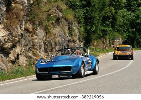 CAINO (BS), ITALY - JUNE 27: A blue Chevrolet Corvette Stingray SCCA / IMSA car takes part to the Nave Caino Sant'Eusebio race on June 27, 2015 in Caino (BS). The car was built in 1969. - stock photo