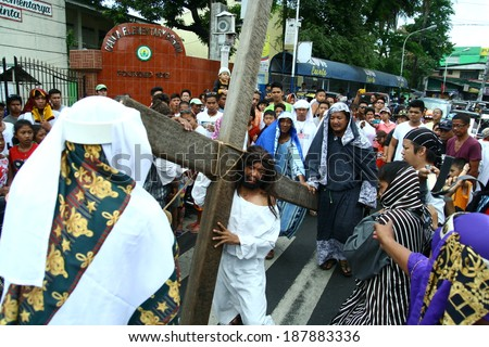 cainta, rizal, philippines. april 18, 2014. catholic devotees imitate or reenact the suffering of jesus christ. they walk, carry a crossand whipped. this tradition is done yearly on good friday.