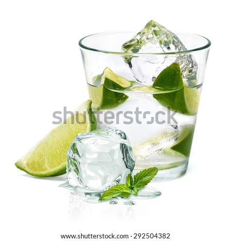Caipirinha cocktail with lime wedge isolated on white background