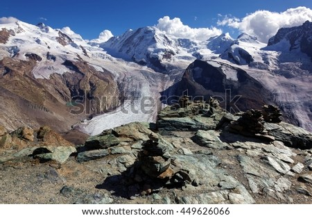 Cairn and the Gorner Glacier,a valley glacier on the west side of the Monte Rosa Massif,close to Zermatt, Switzerland. The second largest glacial system in the Alps after the Aletsch Glacier system. - stock photo