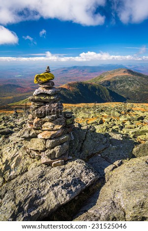 Cairn and view of the White Mountains from Mount Washington, New Hampshire. - stock photo