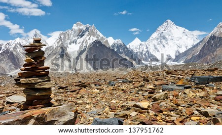 Cairn in the Karakorum Mountains, Pakistan. K2 in the background.
