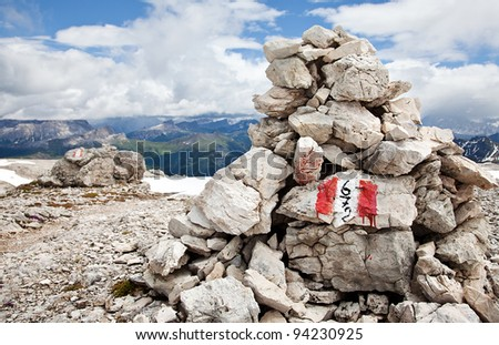 Cairn marking a hiking trail in the mountains - stock photo