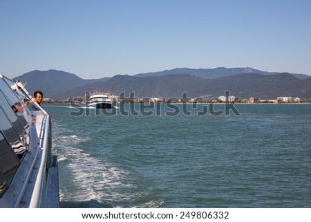 Cairns, Australia - September 18: View of passenger ferries at the Great Barrier Reef near Cairns, Australia on September 18, 2014. - stock photo
