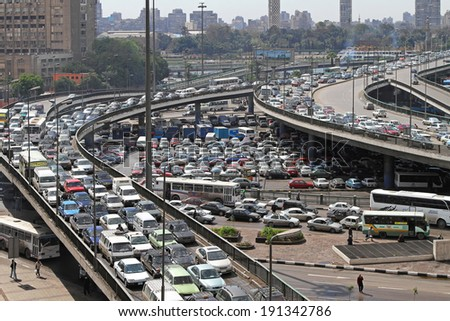 CAIRO, EGYPT - FEBRUARY 25: Cairo traffic jam on FEBRUARY 25, 2010. Transportation collapse at main intersection in Cairo, Egypt. - stock photo
