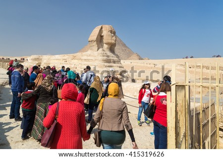 CAIRO, EGYPT - FEBRUARY 3, 2016: Group of tourists around the Great Sphinx of Giza, Egypt. - stock photo