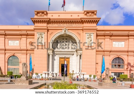 Cairo, Egypt - January 4, 2015: The Egyptian Museum in Cairo, one of the most famous museums of the world. Tourists come through the main entrance into the museum.