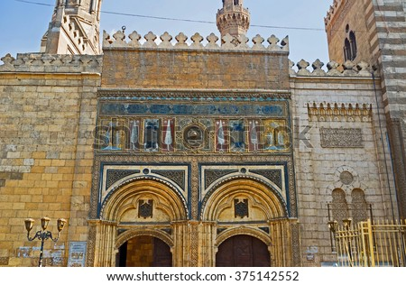 CAIRO, EGYPT - OCTOBER 10, 2014: The Bab al-Muzainin (barbers' gates) is the central entrance to Al-Azhar Mosque decorated with floral patterns and medieval calligraphy, on October 10 in Cairo.
