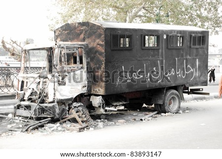 CAIRO - 01 FEBRUARY: Burnt out riot police truck. Cairo, Feb 1, 2011 - stock photo