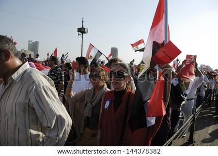 CAIRO - JUNE 30: Unidentified women in the rally over Qasr el-Nil bridge heading to Tahrir Square to join the protesters on June 30, 2013 in Cairo, Egypt.