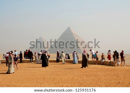 CAIRO-NOV 22: Visitor in front the great pyramid on Nov 22 2000.The number of tourists visiting Egypt dropped by more than a third since the Egyptian revolution on Jan 25 2011. - stock photo