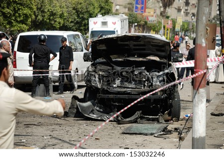 CAIRO - SEP 05: One of the exploded cars belongs to interior minister's convoy after the explosion that was targeting the Interior Minister in Mostafa Nahas st, Cairo, Egypt on September 05, 2013 - stock photo