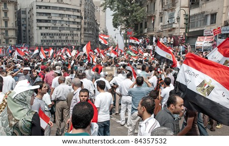 "CAIRO - SEPTEMBER 9: Thousands of Egyptians converged on Cairo's Tahrir Square to demand reforms in a turnout dubbed ""correcting the path of the revolution"" in  Cairo, Egypt on September 9, 2011 - stock photo"