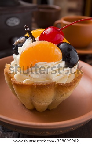 Cake - a basket of dough with cream and cherry. - stock photo