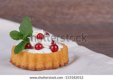 Cake basket with berries on  brown background