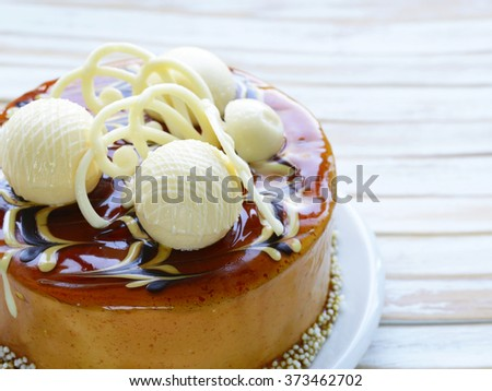 cake caramel biscuit decorated with white chocolate - stock photo