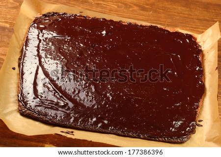 Cake covered frosting. Making Chocolate Brownie. Series. - stock photo