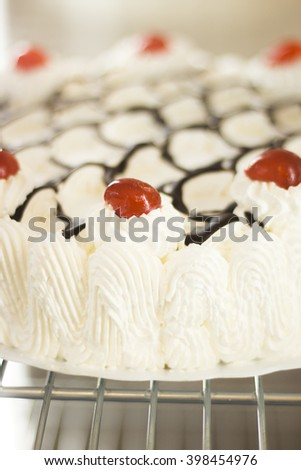 Cake cream dessert with red cherries photo. - stock photo