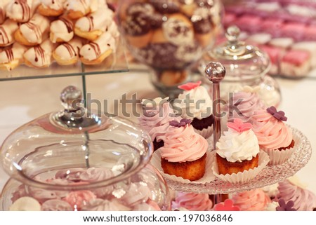 Cake cups on table - stock photo