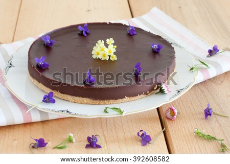 Cake decorated with flowers on a wooden boards - stock photo