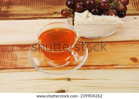 cake dessert and tea and grapes on wood - stock photo